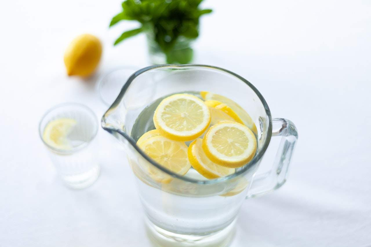 Drinking Lukewarm Water with Lemon Meaning Benefits Pros Advantages Limitations Cons and Disadvantages for Coronavirus (Covid-19) Photo